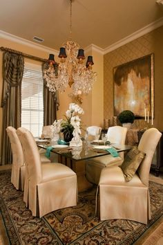 .I love the aqua accents in this warm dining room.
