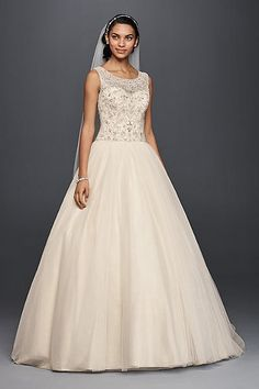 Tulle ball gown wedding dress with a crystal-beaded tank illusion bodice and simply striking layered skirt made of 50 yards are ballerina-worthy…