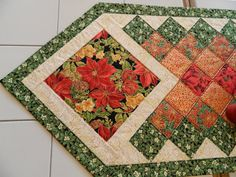Holiday Quilted Poinsettia Table Runner by Quiltsbysuewaldrep