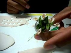 how to make two really easy mini clay flowers  by Pedro Ramirez.  His flowers are phenomenal!