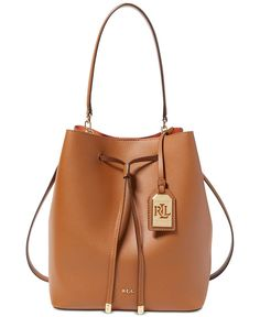 A contrasting interior takes this lightweight drawstring Lauren Ralph Lauren bag from basic to chic. Plus, it comes with a removable pouch to keep your essentials within reach. | Leather; interior: fa
