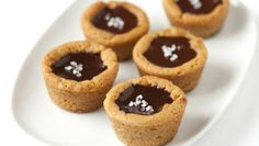 Bloggers Adam and Joanne Gallagher from Inspired Taste share a favorite recipe for Salted Chocolate Cookies Cups. Enjoy a small piece of heaven with this smooth combination of chocolate and salt in a compact cookie cup.