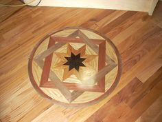 Hardwood floor with a floor medallion installed.