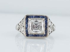 Antique Engagement Ring Art Deco Era 1.14 ct GIA Asscher Cut Diamond With Sapphires In Platinum