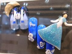 Insane and adorable Cinderella nails from the Tokyo Nail Expo Nail Art Competition 2009.  Yes, Cinderella is ATTACHED to the nail.