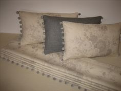 Cushions and Roman blind in Kate Forman's Oyster Roses linen, plus a plain wool cushion.