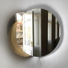 ECLIPSE MIRROR/SCONCE BY ROOMS