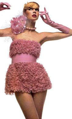 Photo by Toscani, 1972. it's pink and...? ruffles?