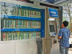 """""""The ChinaDaily news site says that self-service libraries are becoming increasingly popular with Beijing residents, with 50 having sprung up across the city over the past year. 100 more are expected to open in the coming months. The 24-hour service allows readers to choose from 20,000 books housed in giant automatic machines scattered across the capital. A single self-service library, containing more than 400 books, resembles an ATM but is about the size of three cars..."""""""