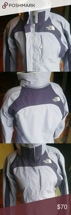Northface Winter Coat Bought new last season and only got to wear it once or twice. Its a kids Large but its equivalent to a women's XS (I wore it and it fit great) the inside is detachable so if you want to wear it as just a raincoat you can do that too. No stains or rips, its practically brand new. Light purple and dark purple North Face Jackets & Coats