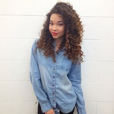 Bit messed with curls I think but still naturally curly? Similar to mine