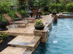 This is the same pool featured in images 134 & This shows the patio surface on the elevated deck area and the steps leading up to it, as well as a side angle of the three sheer descent waterfalls. Pool House Designs, Swimming Pool Designs, Backyard Landscaping, Pool Backyard, Backyard Ideas, Patio Ideas, Garden Ideas, Geometric Pool, Pool Remodel