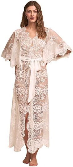 A classic ivory lace robe features exaggerated flutter sleeves and a satin belt. Lace Bridal Robe, Bridal Robes, Lingerie Dress, Bridal Lingerie, White Flowy Dress, Dress Lace, Honeymoon Style, Honeymoon Destinations, Wedding Dresses For Sale