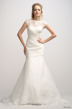Trumpet gown with pleated bodice featuring illusion cap sleeves and V-back. Watters.