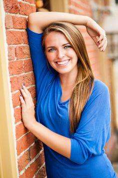 high school senior girl by brick wall - Tavia Larson Photography - Boiling Springs Photographer