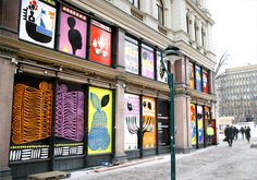 Art prints in the windows of the flagship Marimekko store, Helsinki, Finland, 2012, by Aino-Maija Metsol.