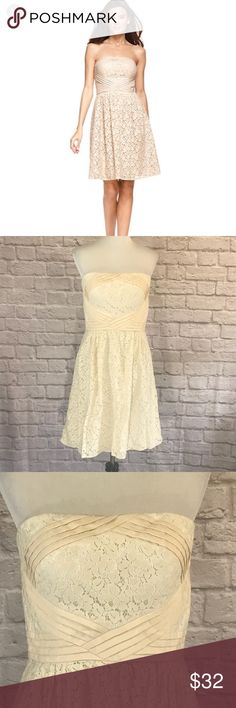 Vince Camuto cream lace strapless dress size 10 Vince Camuto cream lace strapless dress size 10. This dress has tucks on the bodice to form a diamond pattern inlaid with lace on the front. The tucks are also at the waist line. There is boning on the sides and a built in bra with boning. This dress is lined. Please see pictures for details and measurements. Thanks for visiting my closet! Vince Camuto Dresses Strapless