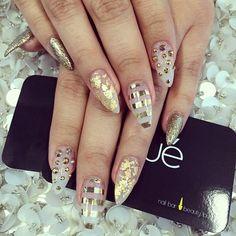 gold foil stiletto nail art