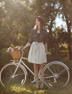 Perfect outfit, cute bike (I wouldn't ear a skirt while biking, but  I like the image it evokes)