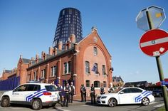 Police stand guard after an ISIS attack in Belgium wounds two cops.