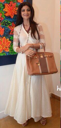 Shilpa Shetty in a white anarkali and statement tote bag.