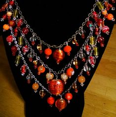 Bright Orange 3 strand I make these from chosen glass beads. On tri colored chains. I love designing. And these are my creations. Custom orders are excepted. I can make it in different colors. Pam's Gem Collection Jewelry Necklaces