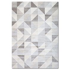 Silken Subtlety. The Sonoma Geo Triangles area rug's viscose yarns are woven in Belgium with a precise, machine-loomed technique to give the look and feel of real silk. It features a sophisticated group of designs at a great price. This rug resists stains and fading.