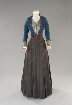 Tirelli Costumi, 1900's day dress, two-piece, blue and black striped brown wool skirt, bodice in blue wool tweed on a printed corsage, red satin soutache, designed by Mariano Tufano for New World, Terrence Malick, 2005