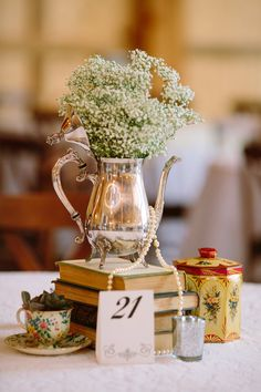 Silver & Lace vintage barn wedding.  photo by The Tarnos.  Bride and Groom.  Inside barn Wedding.  Silver Teapots & table decor by Rent My Dust.