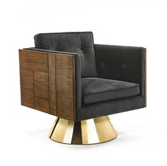 This Swivel Lounge Chair from the Lily Jack Burgundy Collection features Walnut veneers and a metal base