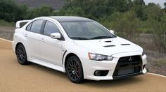 2015 Mitsubishi Lancer Evolution FE -- Confused about what to buy? Call 1-800-CAR-SHOW for a Product Specialists who will help you for FREE. 300 models to choose from: Coupes, Sedans, Station Wagons, Minivans, Crossovers, SUVs, Pickup Trucks