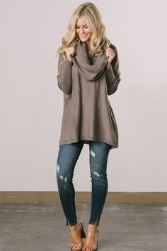 Chic sweaters are one of our favorite things about Fall! This gorgeous cowl neck piece is cozy and comfy, and will definitely keep you warm during chilly nights! This sweater is perfect for wearing ov