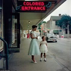 Separated: This image shows a neon sign, also in Mobile, Alabama, marking a separate entrance for African Americans encouraged by the Jim Crow laws - article and more pictures