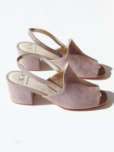 Subtle mauve suede sandal with a delicate, elasticized back strap and low heel. Peep toe. Fully lined. Material: Lamb suede upper with stacked wood heel and natural leather sole. Handmade in Peru. Siz