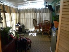 Back patio enclosed using painters canvas drop cloths. It's been a big hit and the patio gets used more than ever. I priced canvas drapes at 145 per panel; this was done with 8 drops totaling $160.