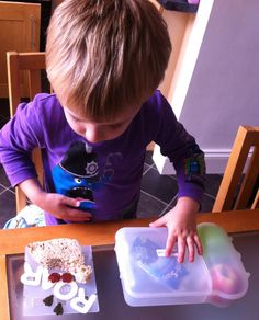 Joseph inspects his lunch #CapriSunSchool