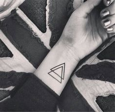 Black Outline Two Triangle Tattoo On Wrist