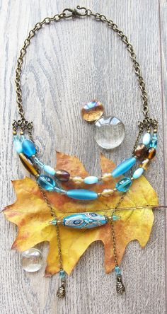 In focal point of this necklace in yellow and blue colors I placed a handmade lampwork bead, сomplemented by glass beads, transparent and opaque, handmade and Czech factory production. Everything is combined with bronze fittings.  This item will arrive to you in a pretty safe cardboard box. Ill ship your order within 1-3 business days, and youll receive a tracking number for your package. If you need gift wrap - please just let me know.  Please keep in mind that the color I see on my monitor…