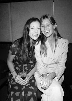 Liv Tyler (actress) with Niki Taylor in a candid moment