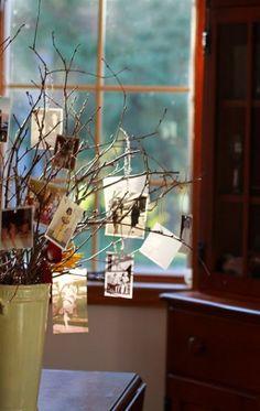 sticks/branches in vase- hang childhood photos/parents/grandparents wedding photos
