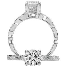 Modern diamond engagement ring featuring a prong set round cut centerstone with leaf detailing on the undergallery and on the shank, which also features bezel set diamonds. {Ritani}