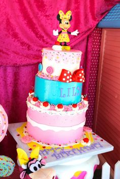 Minnie Mouse Candyland birthday party cake! See more party ideas at CatchMyParty.com!