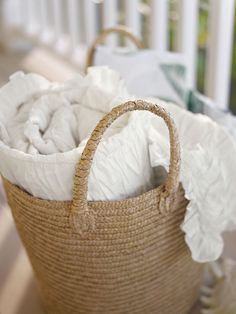 Leave extra linens for guests in a basket. Or beach towels - Pottery Barn