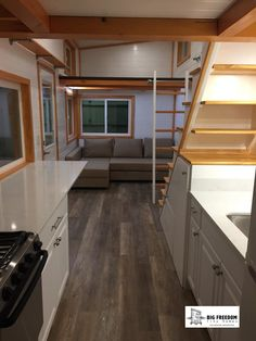 A barn-style tiny house with two bedrooms and a full kitchen! Designed and built by Big Freedom Tiny Homes.