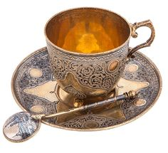 GILT SILVER AND NIELLO CUP, SAUCER, AND SPOON, MARKED P. OVCHINNIKOV WITH IMPERIAL WARRANT, SPOON WITH CYRILLIC MAKERS MARK OF M. F. SOKOLOV, MOSCOW, 1873-1880s