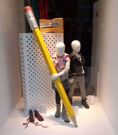 Cool explanation about the principles of design below! By making the window display props larger than the mannequin children, the eye is instantly drawn to investigate the difference in proportion (principle of design)