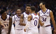 Kansas players Jamari Traylor, left, Devonte Graham, Wayne Selden and Perry Ellis surround Frank Mason before a pair of free throws by Mason during the second half on Friday, Dec. 5, 2014 at Allen Fieldhouse. #KU