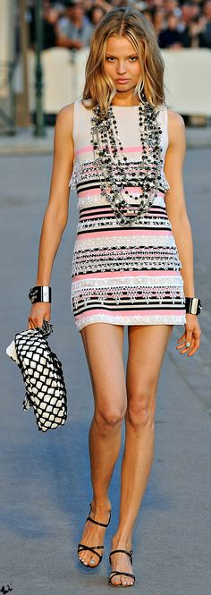 Chanel. Love the dress.  But don't see the need to look like Mr. T with all those necklaces.