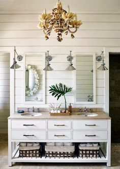 Beachy chic bathroom with seashell chandelier: http://www.completely-coastal.com/2014/09/modern-tropical-decor-pink.html
