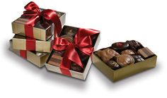 Mini sampler set - A set of four ribboned boxes, each with an assortment of favorite chocolates to give as a set or individually.  New products from our kitchens are sometimes featured in our assortments creating slight variations from photo.  Ribbon color varies with the seasons.